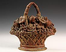 CAST IRON FLORAL DOORSTOP - 19th c. Flower Basket Form Doorstop with remnants of gilding over red paint. 11 1/2