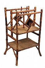 BAMBOO MAGAZINE RACK - Scorched Bamboo Rack with two partitions having chinoiserie lacquer panels, both shelves covered in woven seagra