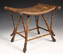 BAMBOO STOOL - Scorched Bamboo Stool in Egyptian Revival form, with concave seat, diagonal braces and legs ending in root balls. Circa