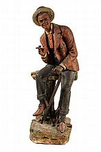 BLACKIANA FIGURINE - Painted Plaster Sculpture of a natty young man with straw boater, cigar and umbrella, seated on a fence, smiling j