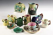 (12) PCS MAJOLICA - Miniatures, including: (7) Creamers, Sugar Bowl, (2) Butter Pats, Apple Blossom Cup & Saucer. Fern & water lily cre