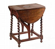 ENGLISH OAK BUTTERFLY TABLE - 19th c. Copy of Jacobean Oval Top Dropleaf Table with barley twist canted legs, ball feet, pivoting swan