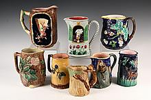(8) MAJOLICA PITCHERS - Various sizes, designs and glazes. 19th c. Some figural. 5