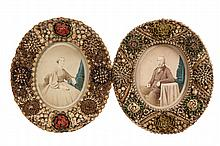 PAIR OF FOLK ART FRAMES - Shell Encrusted Oval Frames, circa 1870, housing hand colored albumen portrait photos of an elderly couple, p
