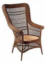 WICKER ARMCHAIR - Wakefield Label, circa 1875, in dark brown paint, Bar Harbor style, tall back with continuous roll arm, basketweave w