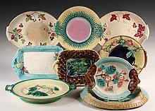 (9) MAJOLICA SERVING PLATTERS - Various sizes, designs and glazes, one is footed with handles. 19th c. 8