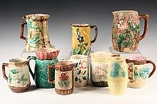(10) MAJOLICA PITCHERS - Various sizes, designs and glazes. 19th c. Most with leaf and bark themes. 6