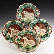 SET OF (4) PLATES - American Majolica Plates decorated with a dog in front of a dog house, in yellow, brown and green. 11 1/4