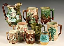 (9) MAJOLICA PITCHERS - Various sizes, designs and glazes. 19th c. Most with leaf and bark themes. 4 1/2