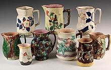 (9) MAJOLICA PITCHERS - 19th c. Pitchers in various forms, designs and glazes, mostly floral. 5