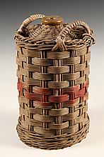WICKER WRAPPED STONEWARE BOTTLE - English Kerosene Jug, circa 1900, with red stripe painted on wicker covering of brown-glazed stonewar