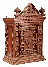 FOLK ART WALL CABINET - Victorian Tramp Art Chip Carved Wall Cabinet in red painted pine, with gabled top flanked by finials, molded to