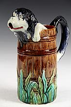 MAJOLICA PITCHER - Figural Pitcher of Spaniel Dog in a Barrel, grass along bottom, marked