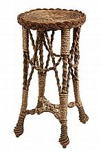 RATTAN STAND - Round Top Four-Legged Stand with seagrass detailing, spiralwork on frame, woven teardrop feet. 25