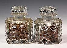 PAIR OF EAPG STOPPERED JARS - Early American Pressed Glass, with festooned swags, blossom form lids, serrated rims, starburst foot. 6