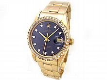 34mm Rolex 14K Yellow Gold Oyster Perpetual Date Watch. Blue 10R Dial. 14K Yellow Gold Oyster Band. - L29668
