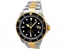 40mm Gents Rolex 18k Gold & Stainless Steel Oyster Perpetual Submariner Watch. Black Dial. 18k Yellow Gold Bezel, black insert. 18k Gold & Stainless Steel Oyster Band. Style 16613. - L29676