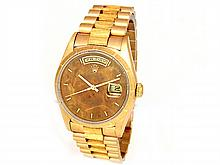 36mm Rolex 18K Yellow Gold Oyster Perpetual Daydate Watch. Wood Dial. 18K Yellow Gold Bark Finish Bezel. 18K Yellow Gold Bark-Finish Band. Style 18248. - L29671