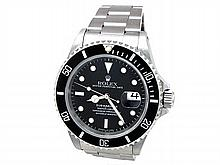 40mm Gents Rolex Stainless Steel Oyster Perpetual Submariner Watch. Black Dial. Stainless Steel Bezel, black insert. Stainless Steel Oyster Band. Style 16610. - L29693