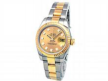 26mm Lady Rolex 18k Gold & Stainless Steel Oyster Perpetual Datejust Watch. Champagne Diamond Dial. 18k Yellow Gold Fluted Bezel. 18k Gold & Stainless Steel Oyster Band. Style 179173. - L29681