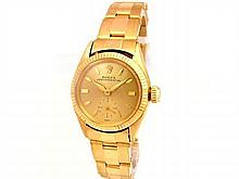 24mm Lady Rolex 18K Yellow Gold Oyster Perpetual Case with 14K Yellow Gold Band. Style 6509. - L29688