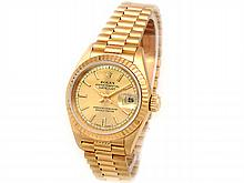 26MM Lady's Rolex 18K Yellow Gold Oyster Perpetual Datejust Watch. Champagne Dial. 18K Yellow Gold Fluted Bezel. 18K Yellow Gold President Band. Style 69178. - L29704