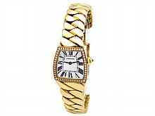 Lady's 18K Yellow Gold Cartier Dona Watch. Silver Roman Numeral Dial. 18k Yellow Gold Bezel with Diamonds. 18k Yellow Gold Band. Style WE60040H. - L29657
