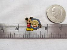 Eisenhower dollar and Mickey Mouse pin