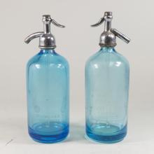 Two Blue Seltzer Bottles