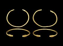 Western Asiatic Late Achaemenid Gold Bracelet Pair with Snake-Head Terminals