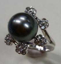 Bague en or gris 8,44gr ornée d'une perle grise me