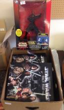 A boxed Star Wars Episode I Darth Maul Interactive Talking Bank with a box of Star Wars Fact File magazines.