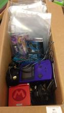 A box of 4 Nintendo Game Boy Colour & Advance handheld consoles and chargers with 12 Game Boy Advance games and 8 Game Boy Colour games to include Star Wars Lego (advance).
