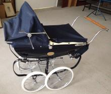 A Limited Edition Silver Cross Millenium dolls carriage/pram in excellent condition with Limited Edition plaques on side #2152/5000 & paperwork, pram bag & accessories.