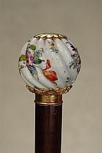 A fine porcelain cane of a Brazilian diplomat