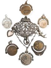Antique chatelaine clip with charms and spinning Bears Mating fob largest overall: 2 1/4