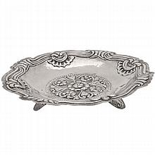 Peruvian silver footed bowl, shaped square form, repousse floral, scroll and shell decoration, three applied tapering feet, one repaired foot, =15.24 ozt., 12.5
