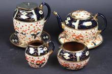 A Victorian six piece tea and coffee set in the imari palette; comprising a tea pot, cover and stand, hot water jug and a stand, cream jug and sugar bowl (6)