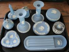 A collection of Wedgwood blue jasper cameo wares, to include; a jasper perfume collection bottle in original box, a salt, pepper and mustard pot, a collection of pin dishes, a lavender jasper plate and further blue jasper plates etc