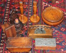 A collection of wooden wares, to include; a money box in the form of a miniature table, a pair of oak candlesticks, a pair of oak Art Deco bookends, a pewter inset box, a letter rack, candle sconce turned wooden bowls etc