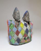 A pair of Ere Ibeji idols with beaded sash, African Art