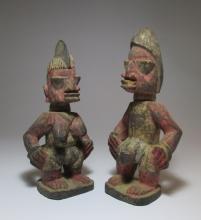 Pair of Red Ere Ibeji twin idols from Yoruba of Nigeria