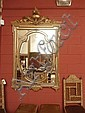 A 19thC carved gilt-wood wall mirror surmounted by