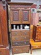 An Edwardian mahogany tall chest of drawers with