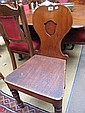 A 19th century oak hall chair