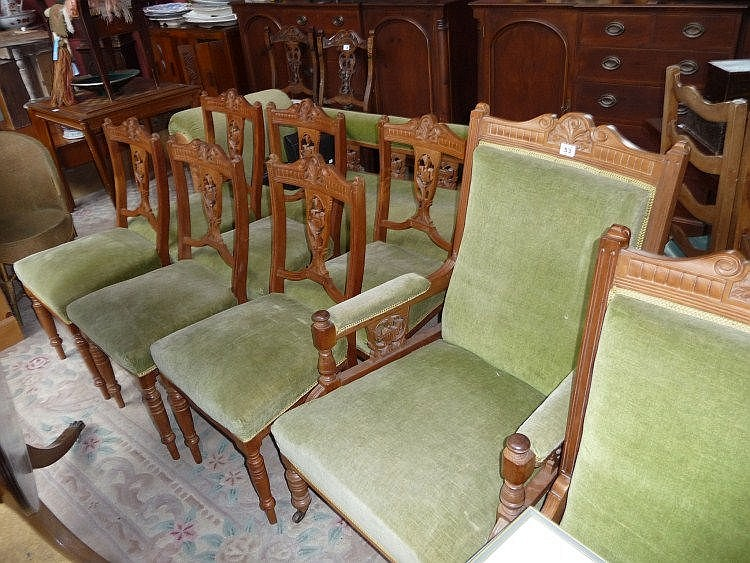 A walnut chaise longue, two armchairs and six