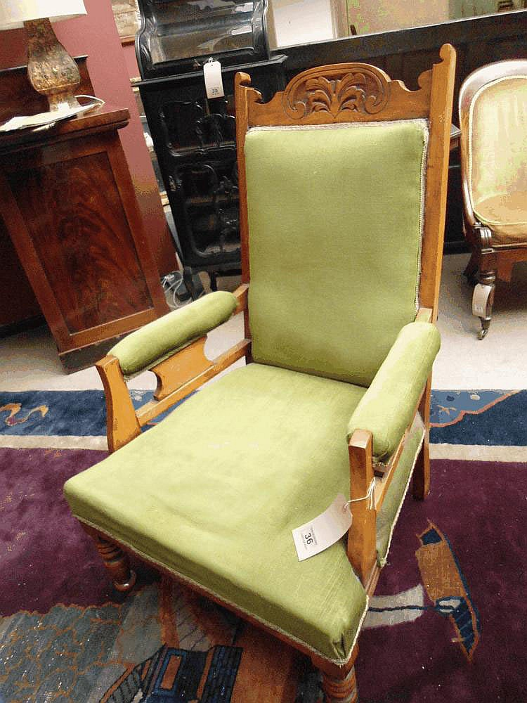 A late Victorian walnut library armchair