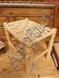 A beech framed stool upholstered in sea grass