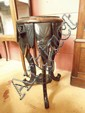 An Eastern ebonised occasional table with carved