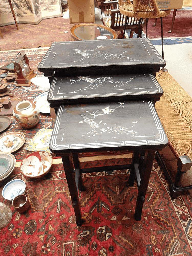 A nest of three Japanese side tables, ebonised and